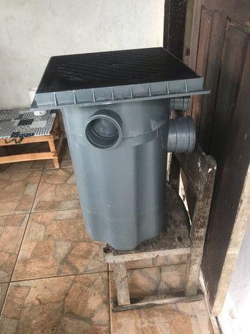 Caixa de esgoto