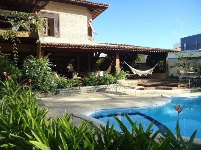 Casa 4/4 3 com varanda, piscina com solarium, 2 vagas