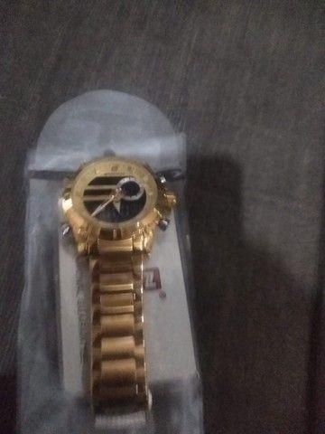 Vende-se  esse relógio dorado - Foto 4