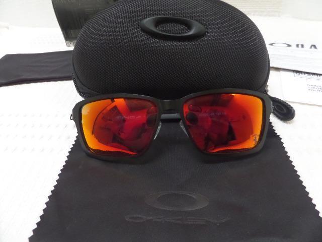 84074af26 Óculos Oakley Tincan Ferrari Preto/Rubi Polarizado - Importado ...