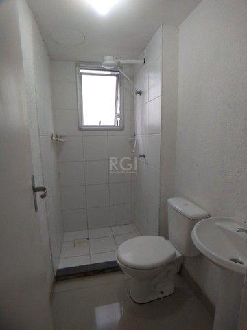 Apartamento térreo  com pátio 2 dormitórios no condomínio Reserva da Figueira no bairro Lo - Foto 8
