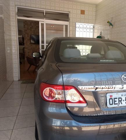 Corolla 2012/2013 Vendo ou troco em carro menor valor - Foto 5