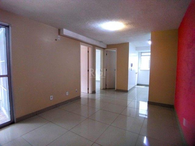 Apartamento térreo  com pátio 2 dormitórios no condomínio Reserva da Figueira no bairro Lo - Foto 3
