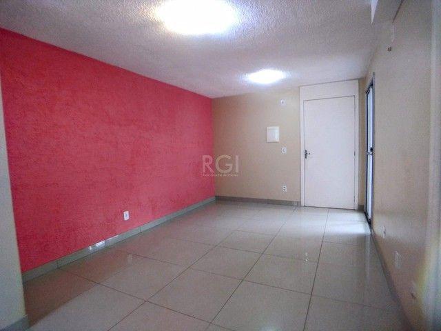 Apartamento térreo  com pátio 2 dormitórios no condomínio Reserva da Figueira no bairro Lo - Foto 2