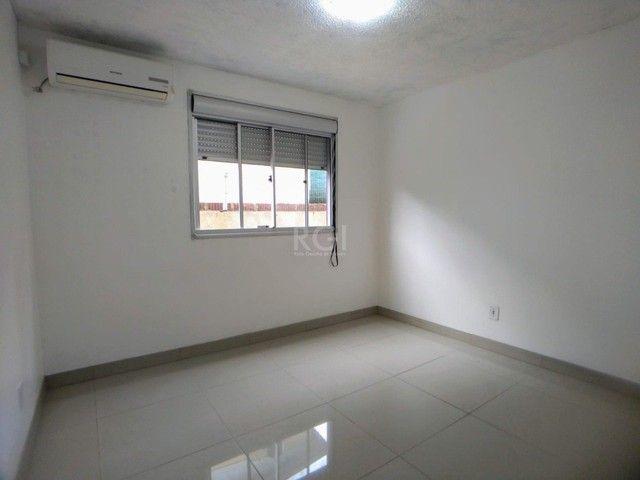 Apartamento térreo  com pátio 2 dormitórios no condomínio Reserva da Figueira no bairro Lo - Foto 9