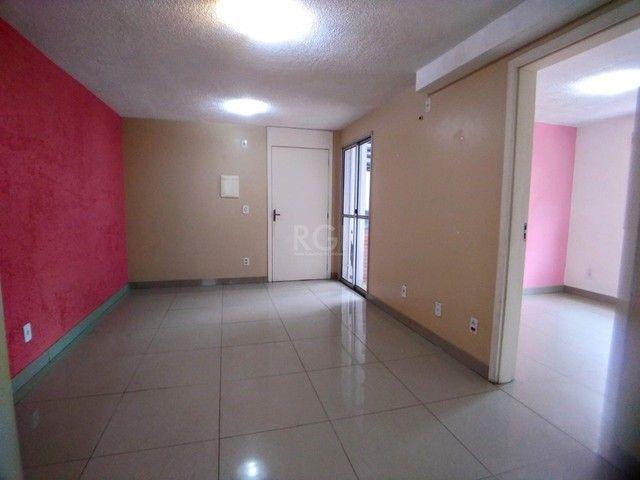 Apartamento térreo  com pátio 2 dormitórios no condomínio Reserva da Figueira no bairro Lo - Foto 5