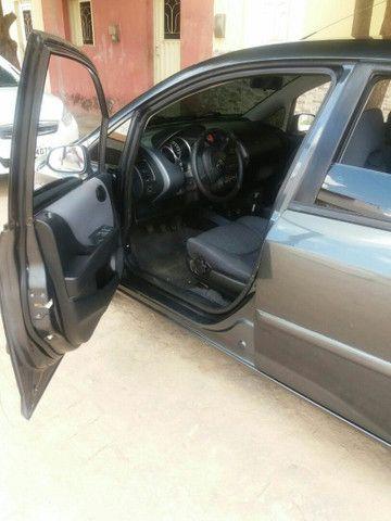 Honda fit vendo ou troco.