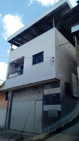 Casa com barracão