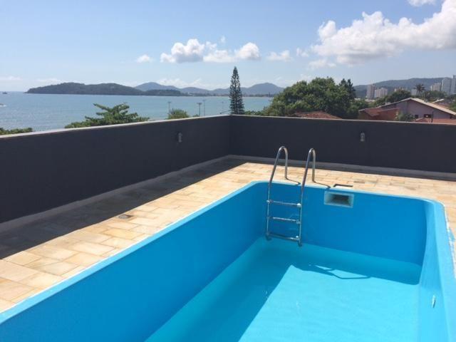 Casa à venda com 4 dormitórios em Centro, Piçarras cod:958