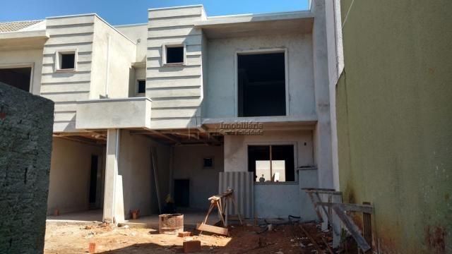 SOBRADO EM CONDOMÍNIO no bairro Santa Felicidade, 3 dorms, 2 vagas - sob134