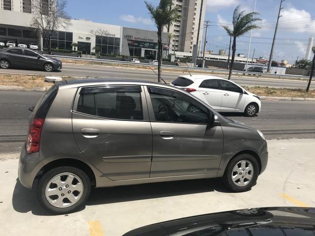 Vendo ou troco carro e volto terreno em Nizia