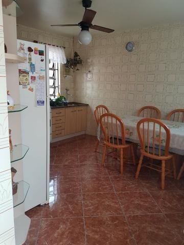 Casa três dormitórios - Foto 12