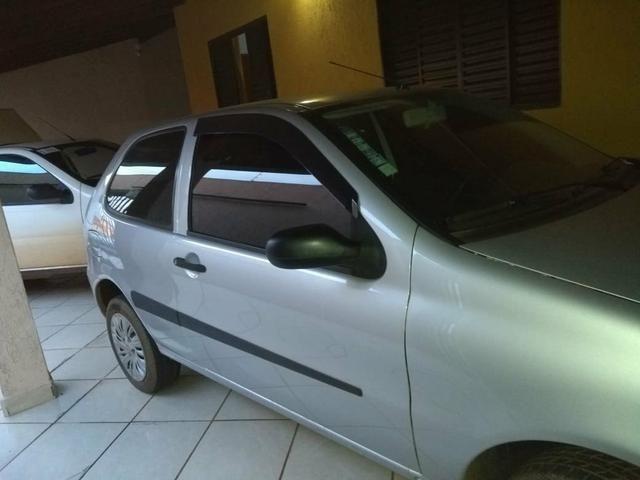 Vendo Pálio fire Economy 2010 2p conservado, vidro escuro, trava e alarme,cor cinza claro - Foto 3