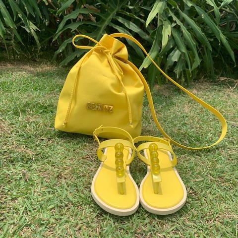 Kit bolsa e chinelos