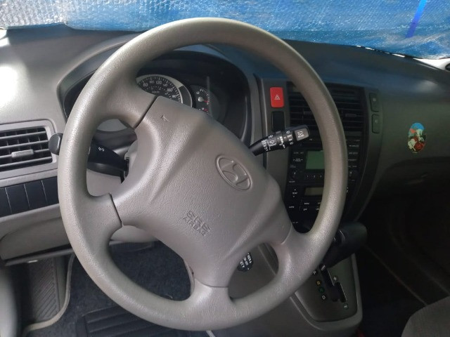 Vendo Tucson completa automática carro de garagem - Foto 9