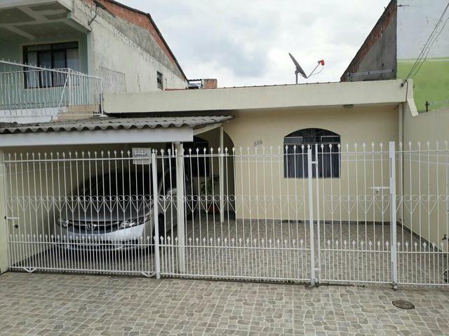Casa no sítio cercado