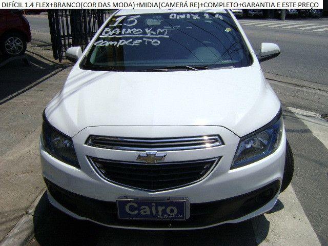 Chevrolet Onix 2013 1.4flex completo ar condicionado laudo aprovado baixa km - Foto 4