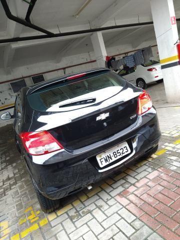 Onix 2016 completo carro impecável ! - Foto 6