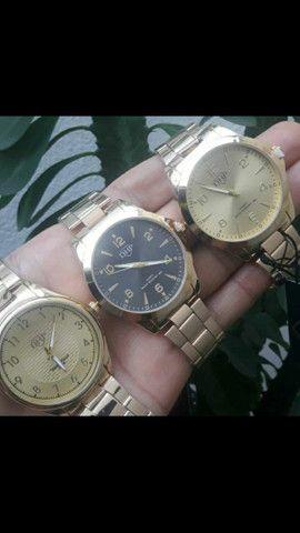 Relógio DHP R$45 original resistente a água