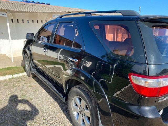 Hilux Sw4 2009 srv a diesel de 7 lugares - Foto 3