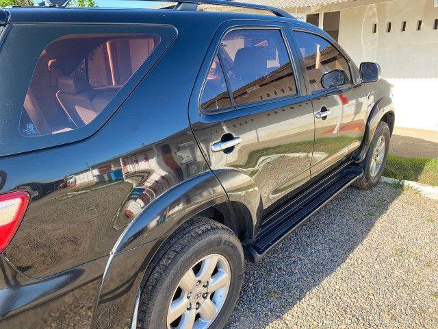 Hilux Sw4 2009 srv a diesel de 7 lugares - Foto 4