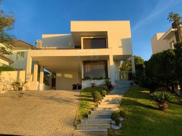 Casa de condomínio para venda com 585 metros quadrados com 5 quartos