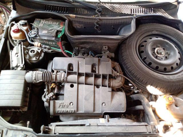 Fiat Uno Vendo Ou Troco (AR CONDICIONADO) - Foto 6