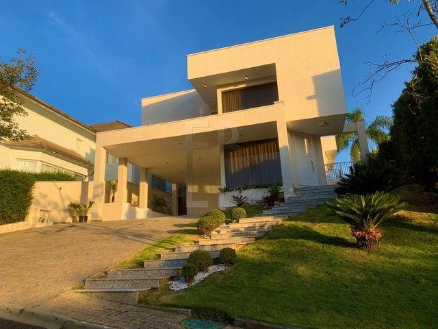 Casa de condomínio para venda com 585 metros quadrados com 5 quartos - Foto 2