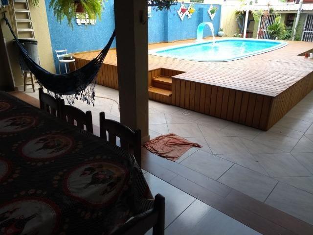 Casa com 4 suítes e piscina, Bombas, Bombinhas. Troco!
