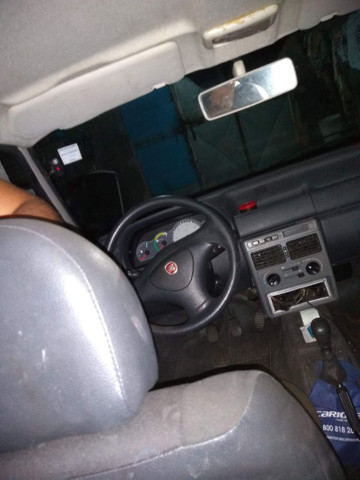 Fiat Uno Vendo Ou Troco (AR CONDICIONADO) - Foto 2