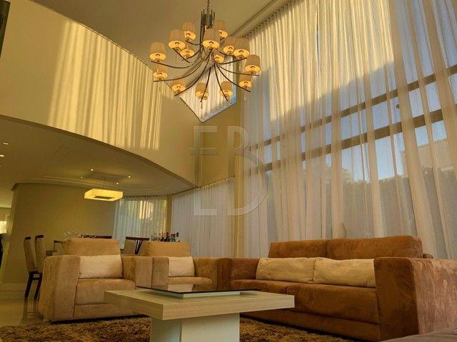 Casa de condomínio para venda com 585 metros quadrados com 5 quartos - Foto 4