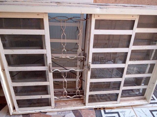 Uma porta e duas janelas - Foto 3