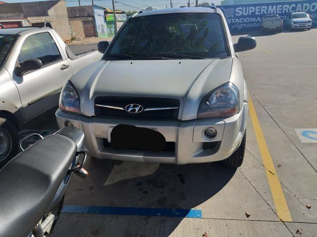 Tucson 2011 manual vendo/troco