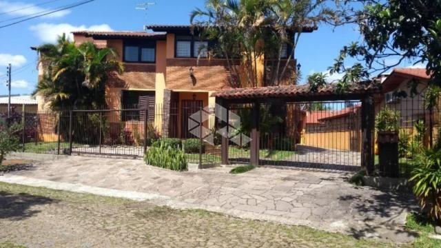 Casa à venda com 5 dormitórios em Guarujá, Porto alegre cod:SO1036
