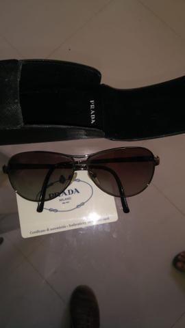 35402ff0dbeb0 Oculos de Sol Prada Milano - Bijouterias