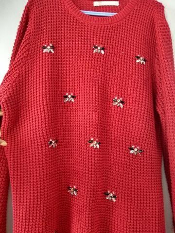 Casaco de tricô vermelho