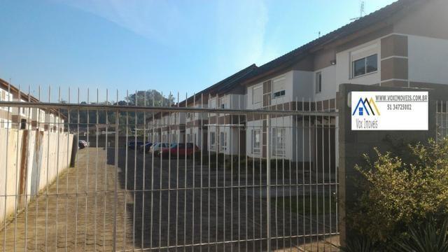 Casa de Condomínio em Nova Santa Rita, com pátio e 2 vagas para carro