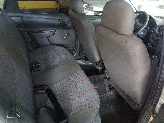 Chevrolet Celta Spirit 2011 completo com GNV.  - Foto 11