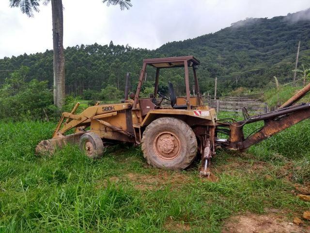 Retro escavadeira Case 580H e MB 1113 caçamba