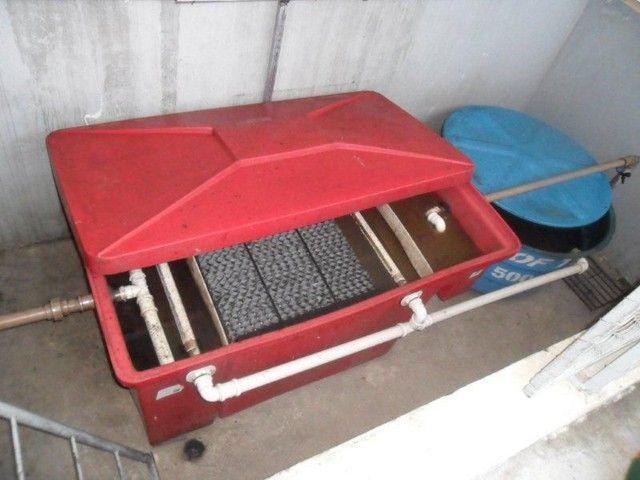 Caixa reparadora de água e óleo