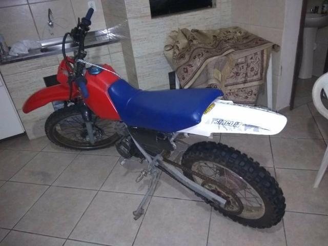 Moto de trilha nx200. top R$2700