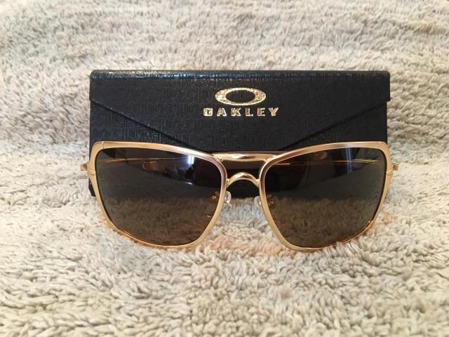 2036a77e78 Óculos Solar Oakley Inmate Polarizado Marrom Armação Dourada ...