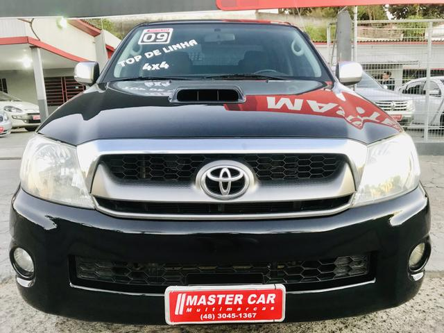 Hilux srv 3.0 diesel turbo 4x4 manual 2009 impecável - Foto 5