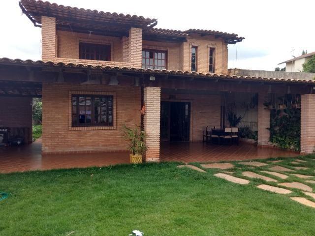 Casa com dois pavimentos em Arquitetura Rústica