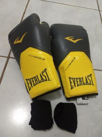 Luvas Everlast 12oz Boxe Muay Thai MMA Kickboxing + BANDAGEM ... e32d33d9839a1