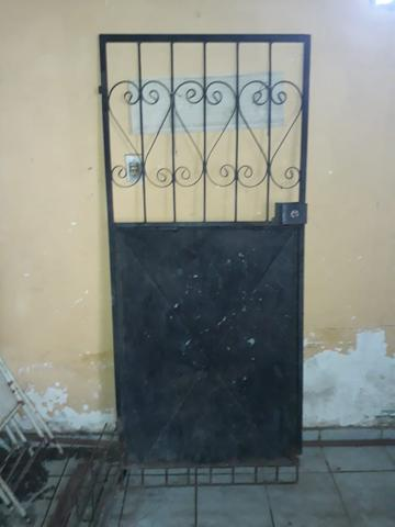Vendo porta de ferro