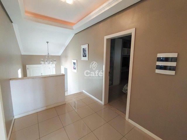 Casa possui 356,07 m² útil, com 4 amplos dormitórios, 2 Suítes sendo 2 master, piscina e s - Foto 15