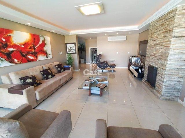 Casa possui 356,07 m² útil, com 4 amplos dormitórios, 2 Suítes sendo 2 master, piscina e s - Foto 4