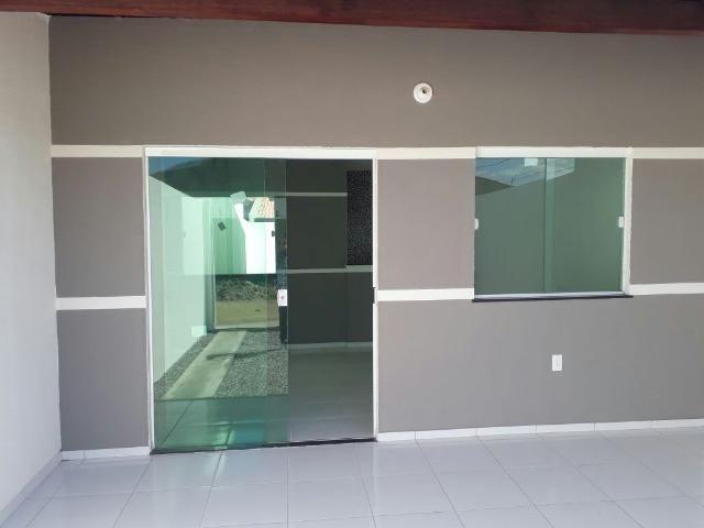 Documentação inclusa: 2 quartos, garagem, sala, cozinha americana, quintal e área de servi