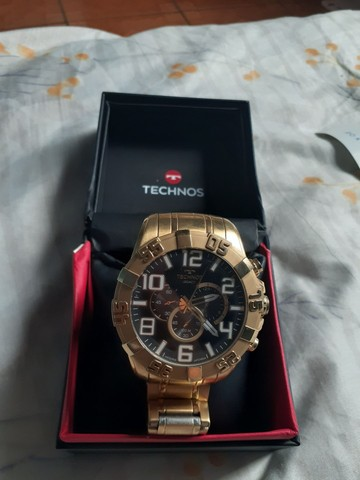 Vendo ou troco relógio TECHNOS dourado.  - Foto 5